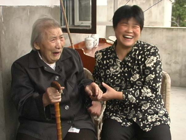 91 yr. old woman and young woman laughing - 2-min