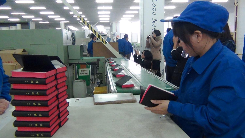 Amity - Bibles on conveyer belt-min