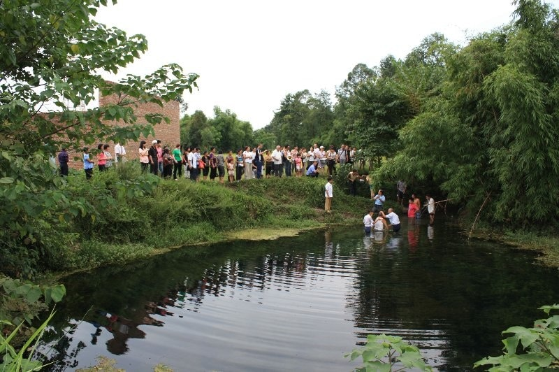 Baptism Ceremony by river - large group-min