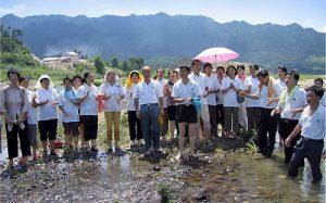 Baptized-members-river-1-min