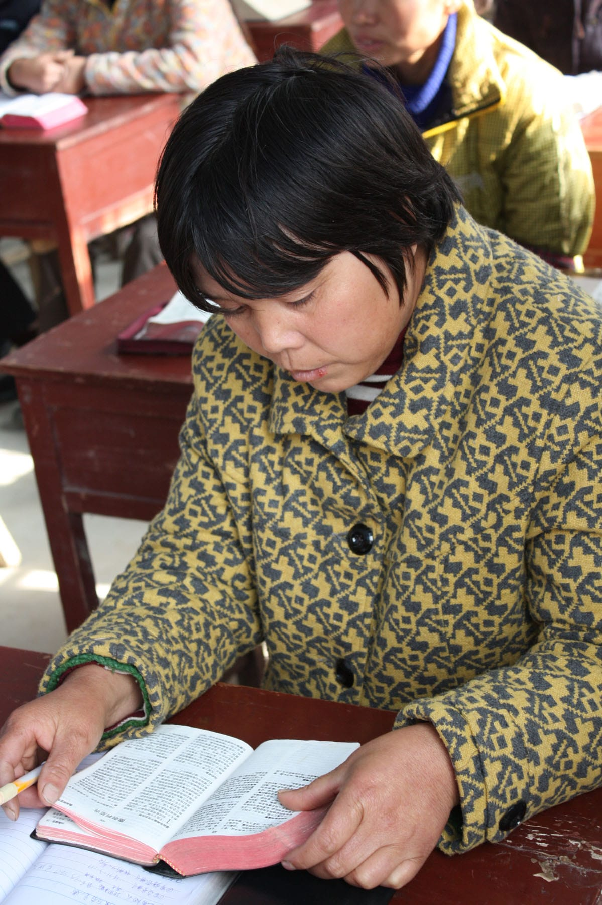 Chinese student reading Bible-min