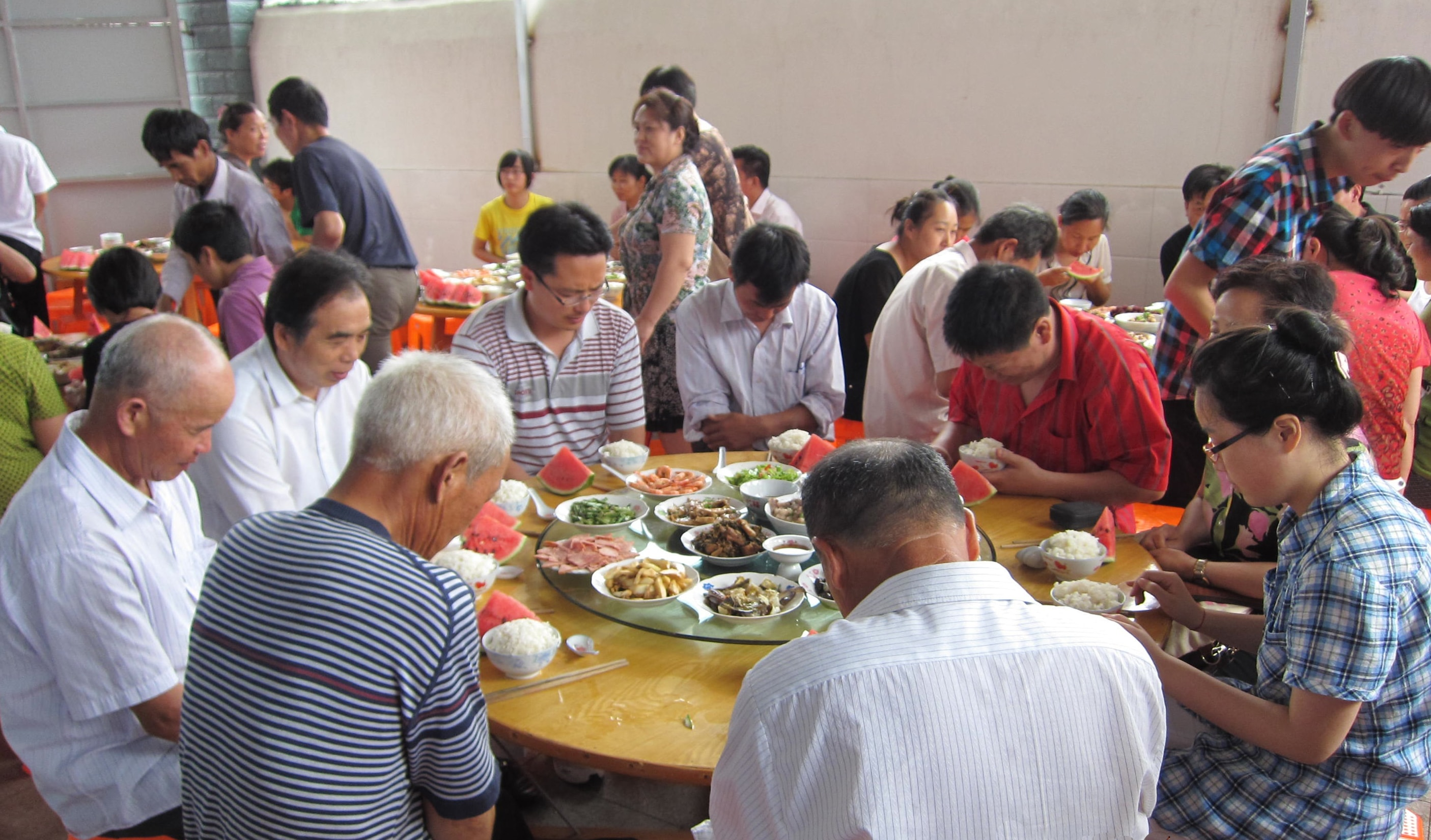 Cixi Church - praying over food-min