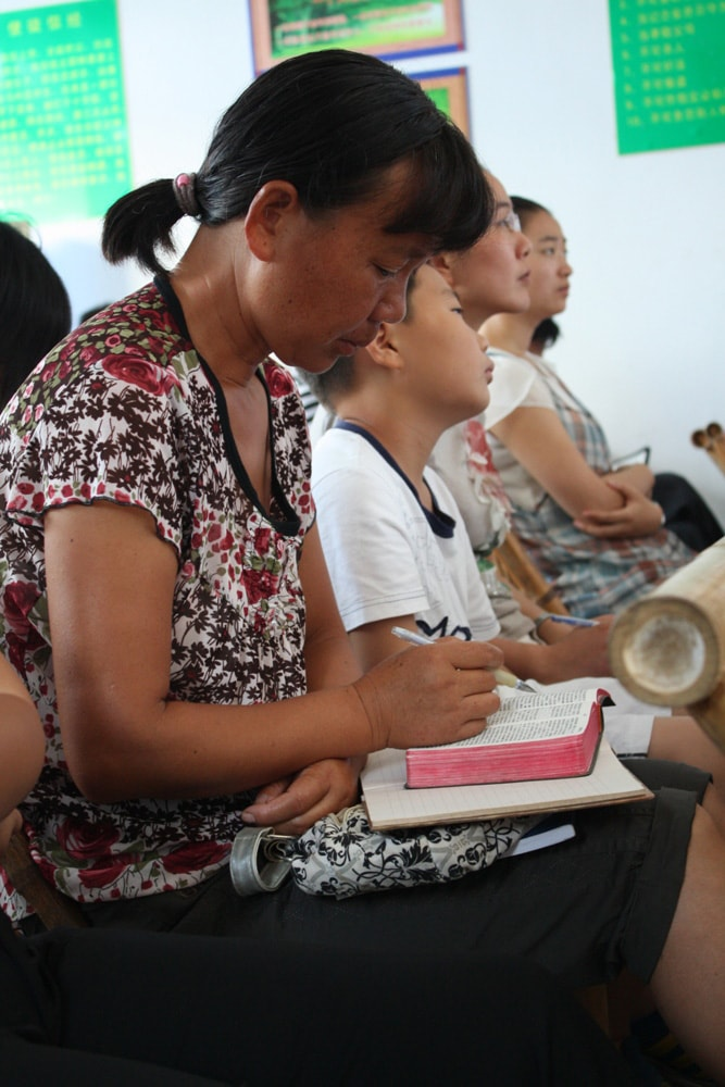 Cixi Training Center - Women studying Bible-min