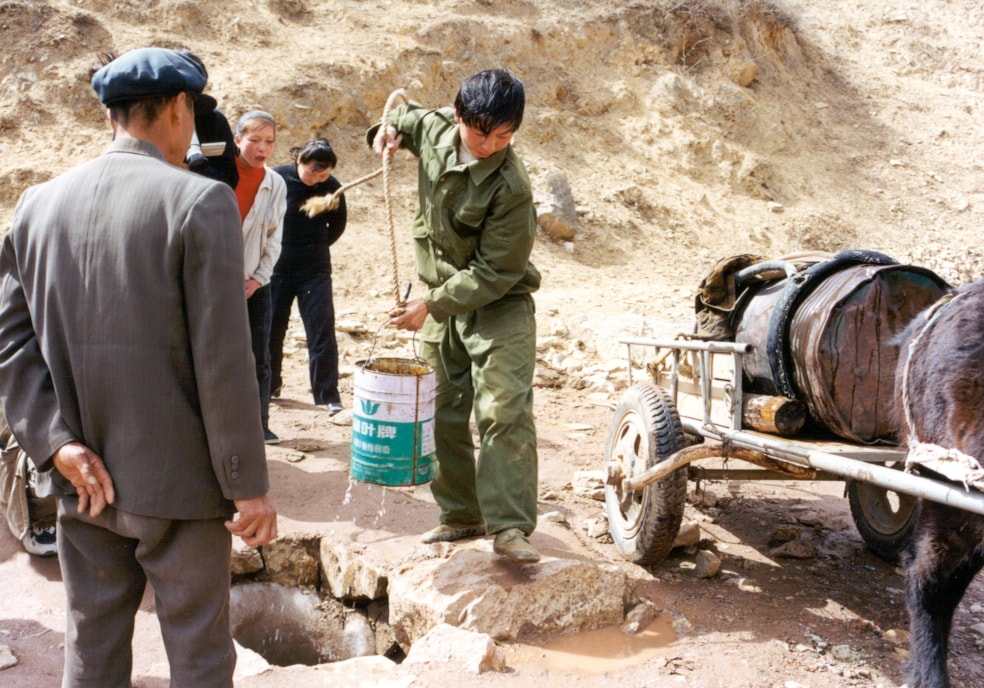 Drawing-water-from-hole---Shanxi-province-min