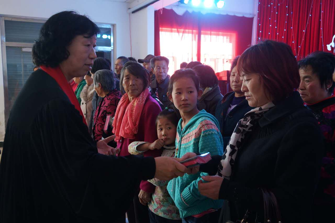 Inner Mongolia - pastor giving Bibles-min
