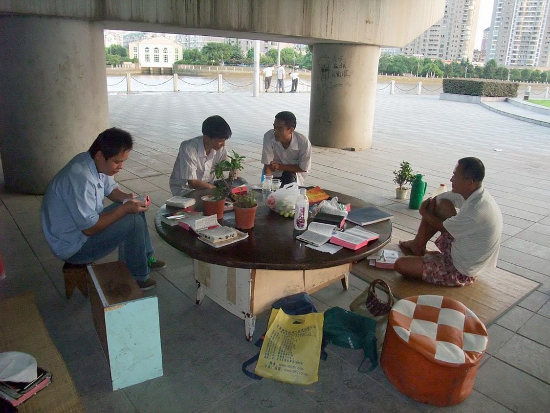 Ningbo-Qin-Bridge-homeless-brothers-around-table-min